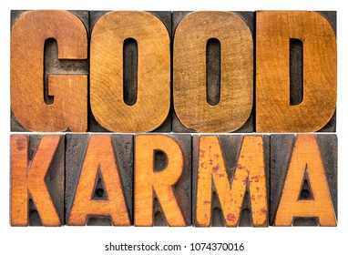 karma word abstract - isolated text in good letterpress wood type printing blocks stained by color inks