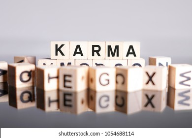Karma word cube on reflection