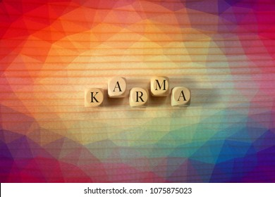 Karma word on wooden cubes. Karma concept