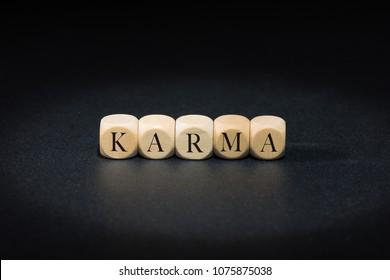 Karma word on wooden cubes. Karma concept