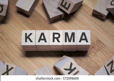 Karma Word Written In Wooden Cube
