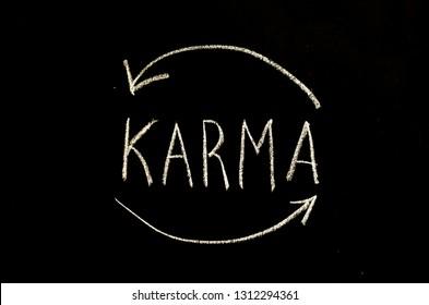 karma written on chalkboard