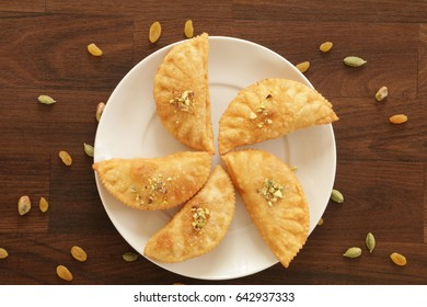 Karnaji or gujia is a sweet dumpling made from maida and stuffed with khoya . It is common sweet in north India and these are usually on festival time.