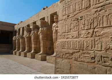 KARNAK TEMPLE - Massive columns inside beautiful Egyptian landmark with hieroglyphics, and ancient symbols. Famous landmark in the world near the Nile River and Luxor, Egypt