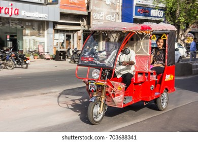 KARNAL, INDIA - MARCH 27, 2017: An electric powered motor rikshaw at Karnal, India. Electric rikshaws are rapidly getting more numerous in India.