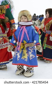 """Kar-Nat, Russia - February 23, 2016: Nenets national holiday """"Day of the reindeer herders"""" in the Yamal Peninsula, Nenets children in national clothes, Kar-Nat, 22 February 2016"""