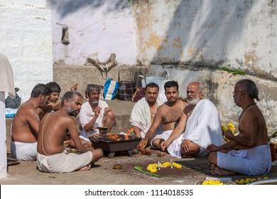 Karnataka, India, November 20th 2011 –  Brahmin priests performing a fire ritual (homa) at a temple in South India.