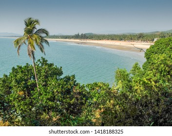 In Karnataka,southwest India.a walk along the southern edge of the cliffs and rocks with Gokarna beach in the distance.