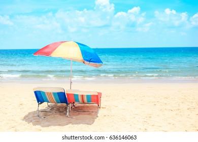 Ka-ron Beach at Phuket , Thailand. White sand beach with beach umbrella. Summer, Travel, Vacation and Holiday concept.