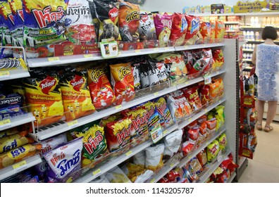 KARON VILLAGE, PHUKET, THAILAND - JUNE 13, 2018: Shelves with goods in a 7 - Eleven (7/11) convenience store