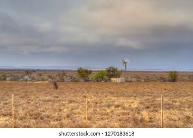 KAROO LANDSCAPES. Windmill on a karoo farm.