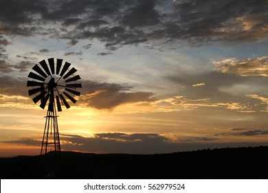 Karoo windmill in the setting sun, Eastern Cape, South Africa.