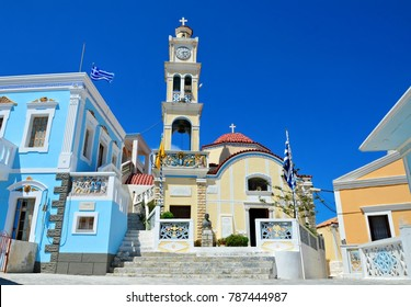 Karpathos island Dodecanese, Greece. August 1, 2014. Panoramic view of a Greek Orthodox church and the surrounding traditional architecture in Karpathos island Dodecanese, Greece.