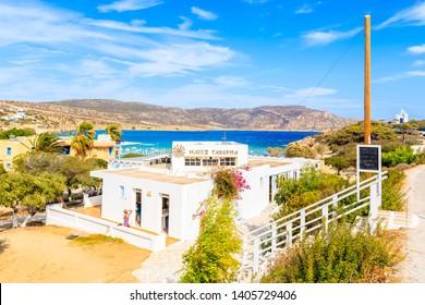 KARPATHOS ISLAND, GREECE - SEP 26, 2018: Traditional white building of Greek taverna near beautiful beach on Karpathos island in Ammopi village, Greece.