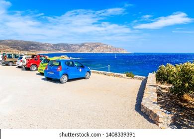 KARPATHOS ISLAND, GREECE - SEP 26, 2018: Rental cars parking on viewpoint on Karpathos island near Ammopi village, Greece.