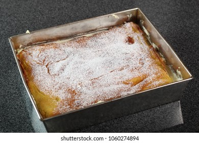 Karpatka in baking pan. Traditional Polish Cream Pie filled with pudding cream.