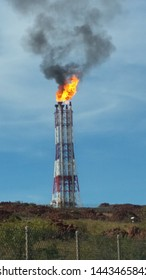 karratha western australia may 2016 a large tower with fire coming out the top