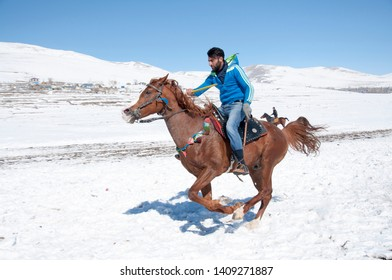 Kars, Selim/Turkey- Feb/18/2017: In winter, young people in Kars do the sport called javelin on horses. This is a javelin show.