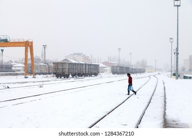 Kars Train Station, Kars / Turkey - 01/24/2016: Unknown man walkin around the railway. Kars, Turkey.