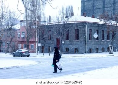 Kars / Turkey - 01/24/2016: An unknown woman walks down the street. Winter. Kars, Turkey.