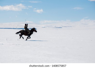 Cıldırlake, Kars /Turkey - 02/17/2017: man rides on the snow on the iced lake