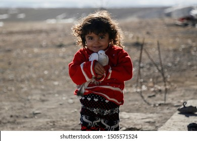 Kars / Turkey - December 26, 2017 : A child holds in his hand a white dove.