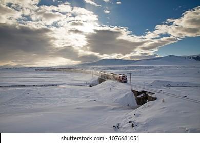 Kars, Turkey - January, 2018: Ankara-Kars (Diesel Train) Eastern Express train in sunrise, Kars, Turkey. The travel of Eastern Express takes 24 hours between Ankara and Kars.