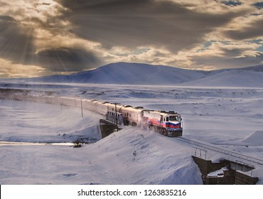 Kars, Turkey - January, 2018: Ankara-Kars (Diesel Train) Eastern Express train in the winter with sunrise. The travel of Eastern Express (Dogu Ekspresi) takes 24 hours between Ankara and Kars.