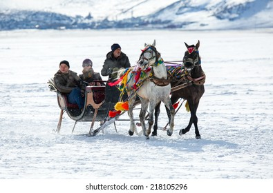 KARS - TURKEY - JANUARY 31: sleigh pulled by a horse in lake frozen cildir. Traditional Turkish winter fun. Cildir lake view at background. Taken on January 31.2014 in Cildir Lake , Kars , Turkey