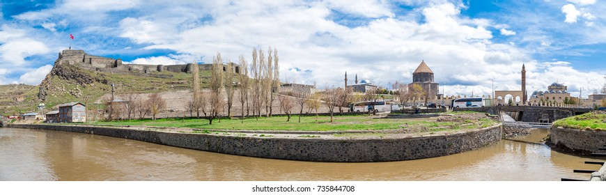KARS, TURKEY - MAY 07, 2017 : Panoramic view of Kars river with the scene of historical Kars Castle on cloudy sky background in Kars, Eastern Anatolia Region Turkey.