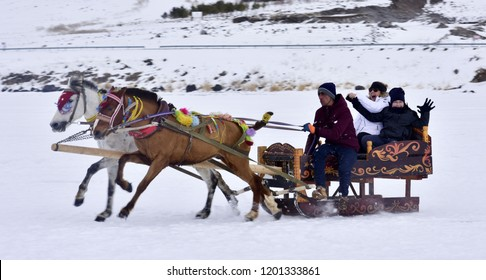 KARS - TURKEY - October 2018: Sleigh pulled by a horse in lake frozen cildir
