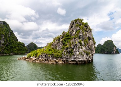 Karst formations in Halong Bay, Vietnam, in the gulf of Tonkin. Halong Bay is a UNESCO World Heritage Site and the most popular tourist spot in Vietnam