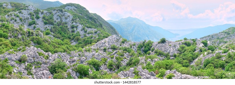 Karst landscape panorama with karren field on the Montenegro karst plateau with background the Kotor Bay, Dinaric mountain.
