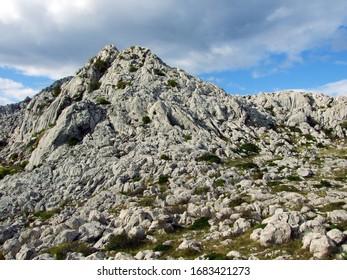 Karst Velebit landscape along the Majstorska road and saddle Mali Alan - Croatia (Krski velebitski krajobraz uz majstorsku cestu i prijevoj Mali Alan, Velebit - Hrvatska) - Shutterstock ID 1683421273