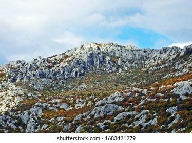 Karst Velebit landscape along the Majstorska road and saddle Mali Alan - Croatia (Krski velebitski krajobraz uz majstorsku cestu i prijevoj Mali Alan, Velebit - Hrvatska) - Shutterstock ID 1683421279