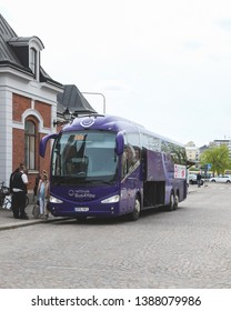 KARSTAD, SWEDEN - MAY 1, 2019: Bus and passengers outside the Central station in Karlstad, Sweden