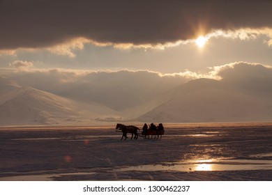 KARS/TURKEY - JANUARY, 14, 2019: Horses pulling sleigh in winter - Cildir Lake, Kars-Ardahan