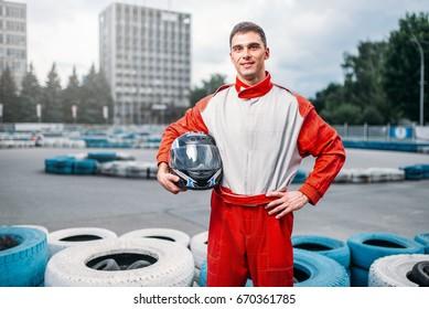 Kart driver with helmet in hands, Go-kart