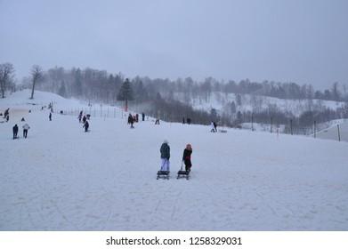 Kartepe sk icenter, Kocaeli, Turkey. People skiing and slading in the snow.