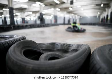 Karting Championship. Driver in karts wearing helmet, racing suit participate in kart race. Karting show. Children, adult racers karting.