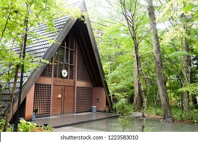 "Karuizawa Church at Nagano, Japan.  Translation of sign on door: ""Hoshino Church"" (church's name)"