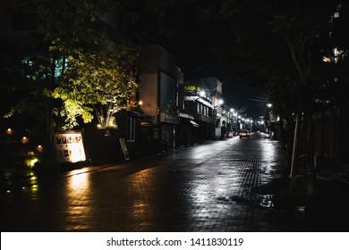 Karuizawa, Japan - June 8 2017:  Wet streets of Karuizawa, a resort town in the mountains near Nagano, Japan