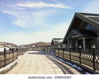 Karuizawa, Nagano, Japan - February 9th, 2013: Blue sky view with white clouds outside Karuizawa station in winter