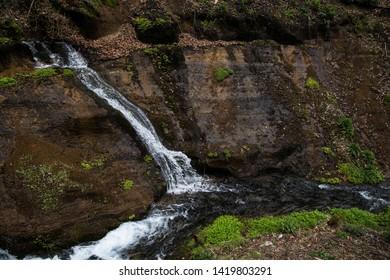 Karuizawa, Nagano, Japan - May 10 2016: Flowing waters of Shiraito Falls, found deep in the mountains of Karuizawa.