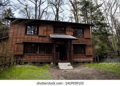 Karuizawa, Nagano, Japan - May 10 2016: A traditional style inn, in the woods of Karuizawa.