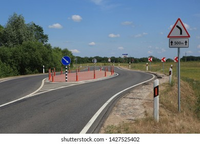 Karvis, Lithuania - June 15, 2019. Road sign on route 108 and countryside view.