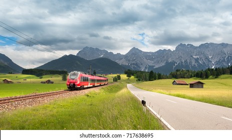 Karwendel mountain panorama with modern train in the foreground of the picture near Mittenwald, Bavaria, Germany