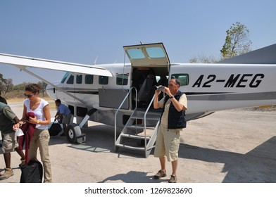 Kasane, Botswana - August, 23, 2013:  Group of tourists arriving in the airstrip,