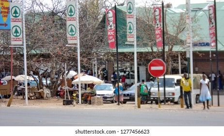 KASANE, BOTSWANA - CIRCA SEPTEMBER 2012: Supermarket parking lot across a street