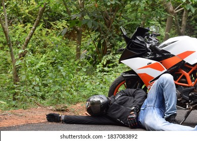 Kasaragod,Kerala,India- August 20 2020 View of a motorcycle accident, a rider falls to the road from the bike